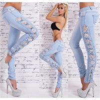 SKINNY DRAINPIPE JEANS WITH CUT-OUTS LACE AND RHINESTONES...